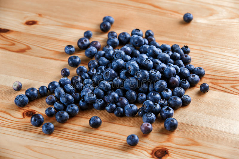 Fresh Organic Blueberries on wooden table. Background.  stock images
