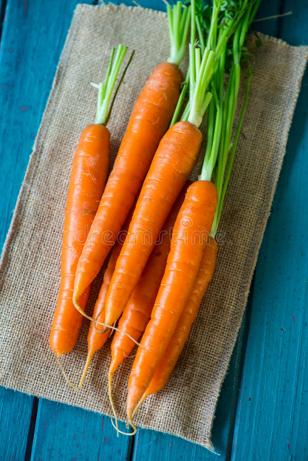 Fresh organic carrots on table royalty free stock images