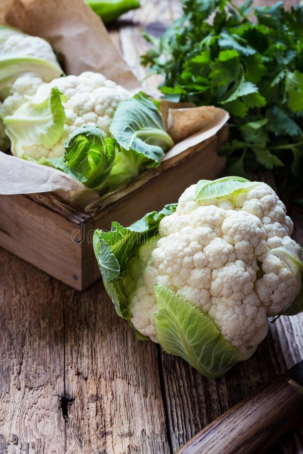 Fresh organic cauliflower, plant based food. Fresh organic homegrown cauliflower in wooden crate, vegan meal, plant based food, close up, selective focus royalty free stock photo