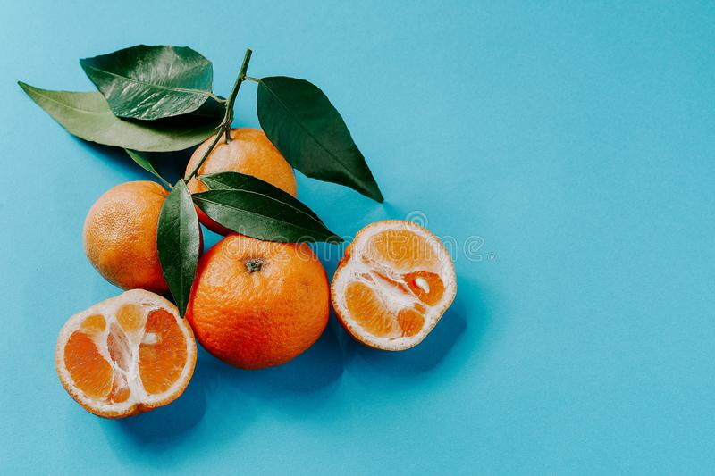 Fresh organic clementines with leaves and with copy space stock photos