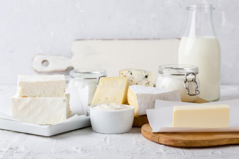 Fresh organic dairy products. Cheese, butter, sour cream, yoghurt and milk royalty free stock photo
