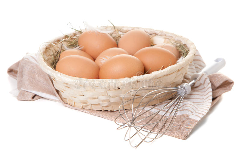 Fresh organic eggs. In a basket royalty free stock photography