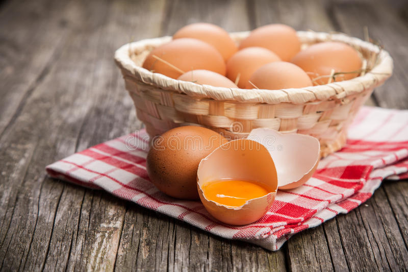 Fresh organic eggs. In a basket stock photography