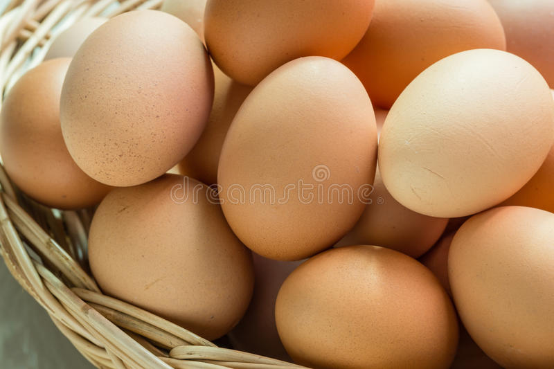 Fresh organic eggs. In a basket royalty free stock photos