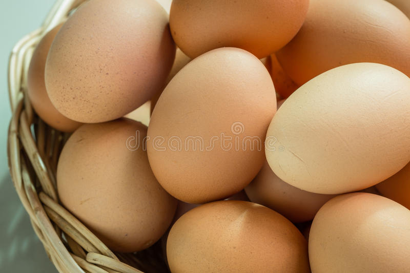 Fresh organic eggs. In a basket stock images