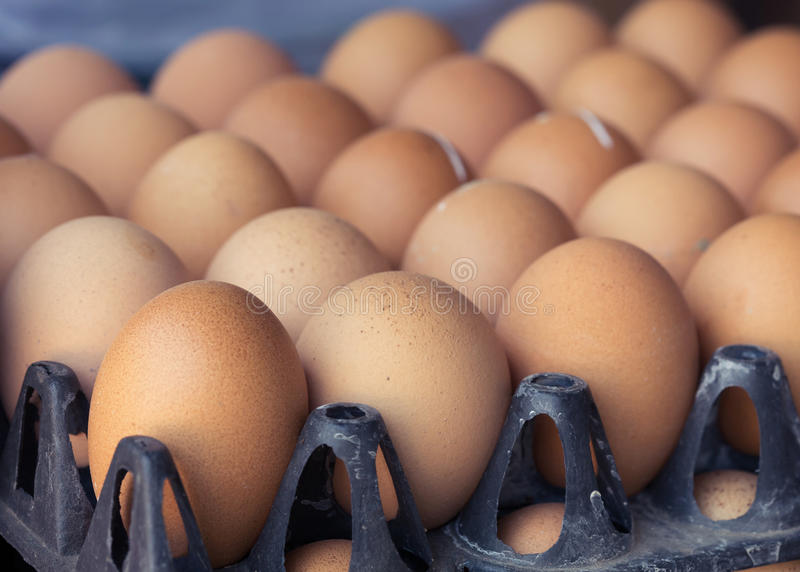 Fresh organic eggs from chicken farm agriculture. For sale at the market, image used vintage filter stock photography