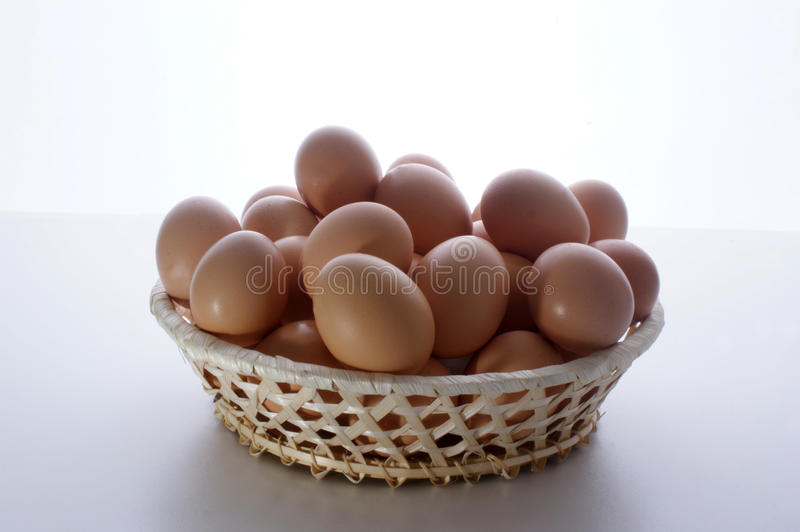 Fresh organic eggs in a hand made basket. Some fresh organic eggs in a hand made basket royalty free stock images