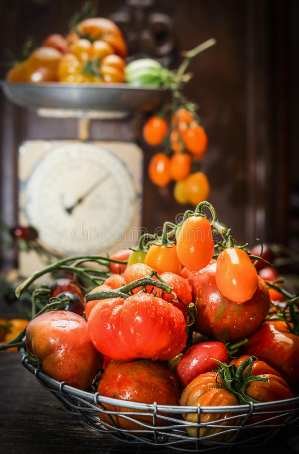 Free Fresh Organic Farm Tomatoes Over Dark Wooden Background And Vintage Scales Stock Photos - 60006893