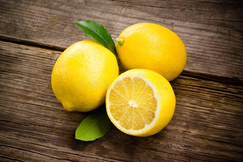 Fresh organic fruit - lemons on wood stock image
