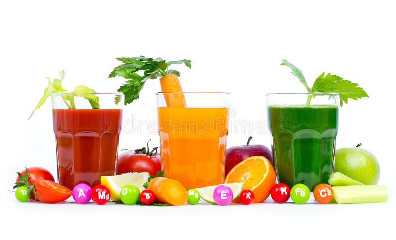 Fresh, organic fruit and vegetable juices. Isolated on white royalty free stock images