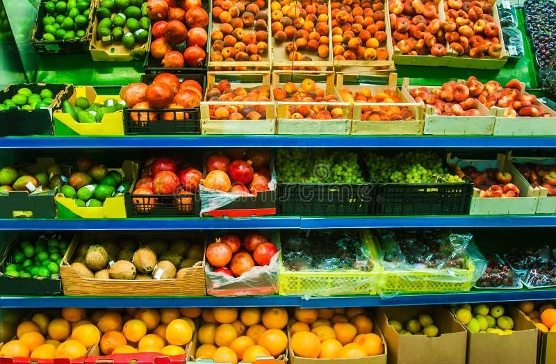 Fresh organic fruits in supermarket farmers market on shelves royalty free stock photo