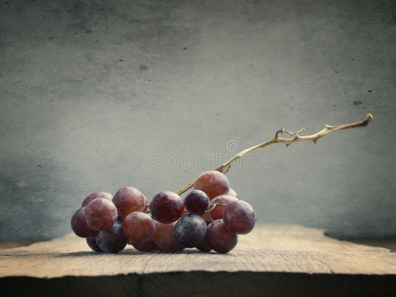 Fresh organic grapes on a wooden table royalty free stock photos