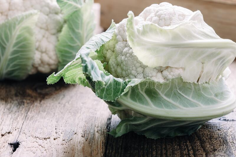 Fresh organic  homegrown cauliflower, sustainable living. Fresh organic  homegrown cauliflower on rustic wooden table, sustainable living, healthy eating, plant royalty free stock images