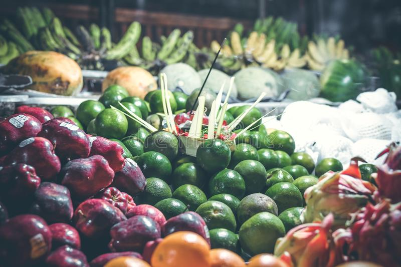 Fresh organic mandarins on the night market. Bali island. royalty free stock photography