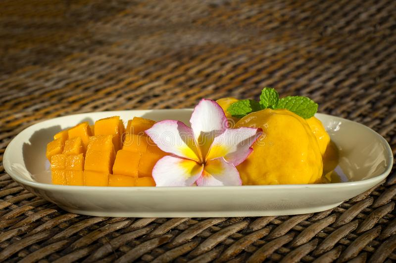 Fresh organic mango ice cream sorbet with mint leaves on table, close up. Thailand stock photo