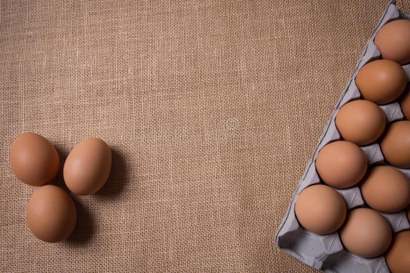 Fresh organic panel eggs on sackcloth with copy space for text royalty free stock image