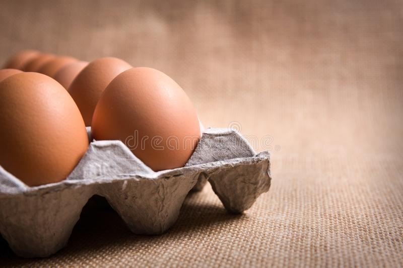 Fresh organic panel eggs on sackcloth with copy space for text royalty free stock photography