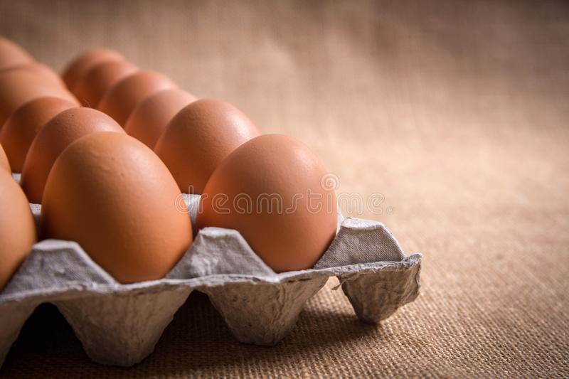 Fresh organic panel eggs on sackcloth gunny with copy space f stock photos