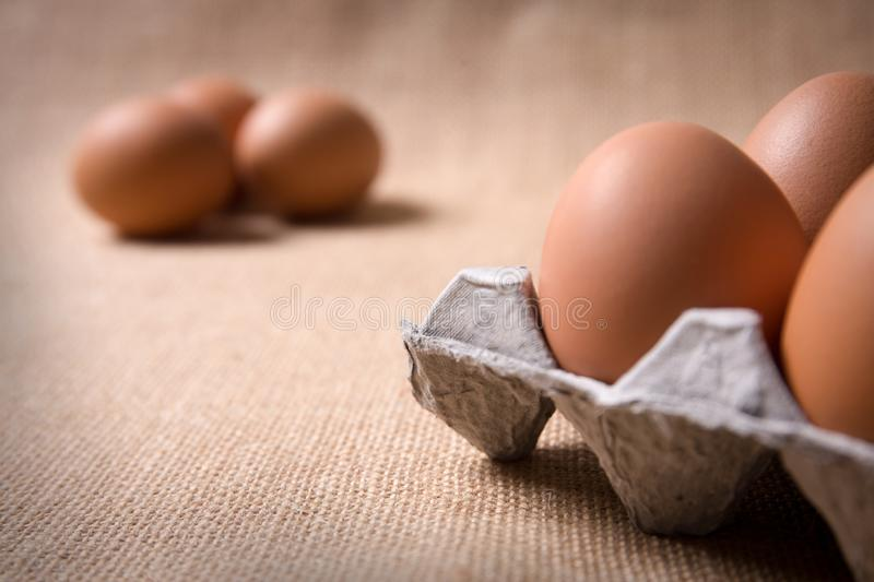 Fresh organic panel eggs on sackcloth with copy space for text royalty free stock images