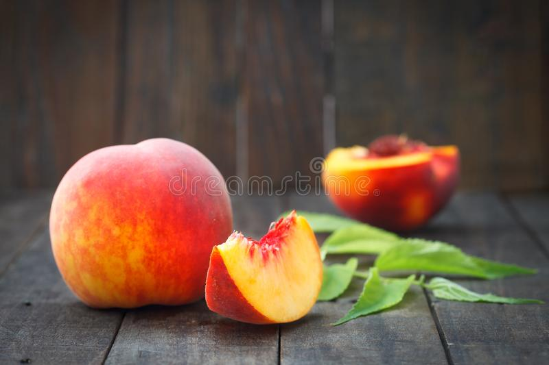 Fresh organic peaches on rustic wooden table stock photos