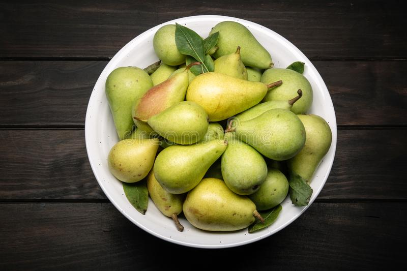 Fresh organic pears in bowl stock images