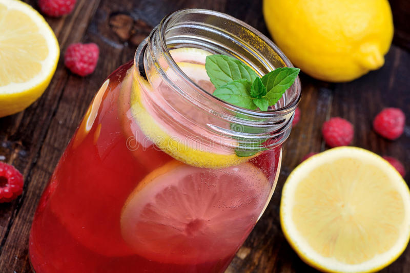 Fresh organic raspberry lemonade in a glass jar on table royalty free stock photography
