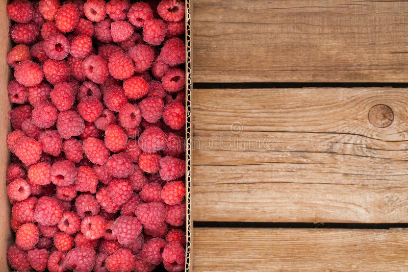 Fresh organic ripe raspberry in box royalty free stock photo