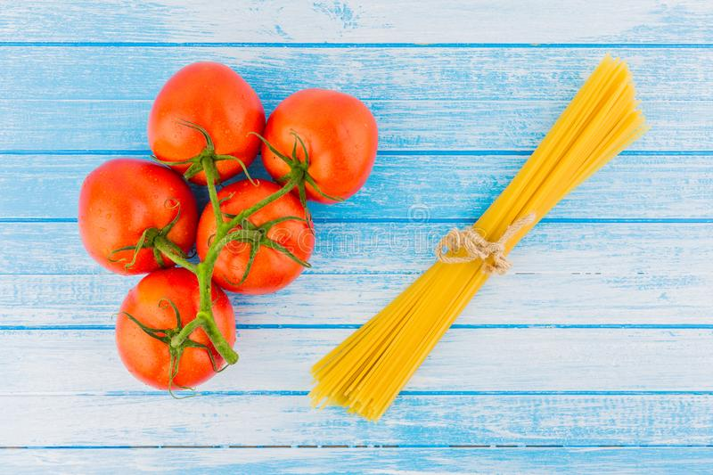 Fresh Organic Tomatoes With Waterdrops And Uncooked Italian Past royalty free stock images