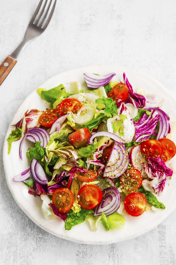 Fresh organic vegetable salad. With onion, lettuce, tomatoes stock photos