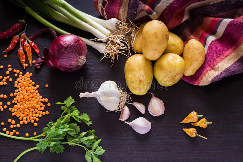Fresh organic vegetables on dark wooden rustic background, top view. stock photo