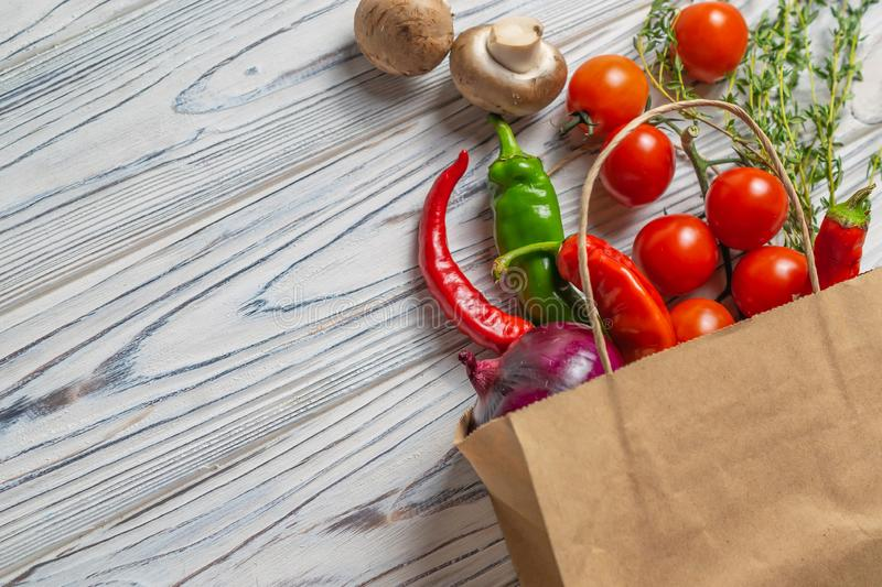 Fresh organic vegetables in eco friendly paper bag royalty free stock image
