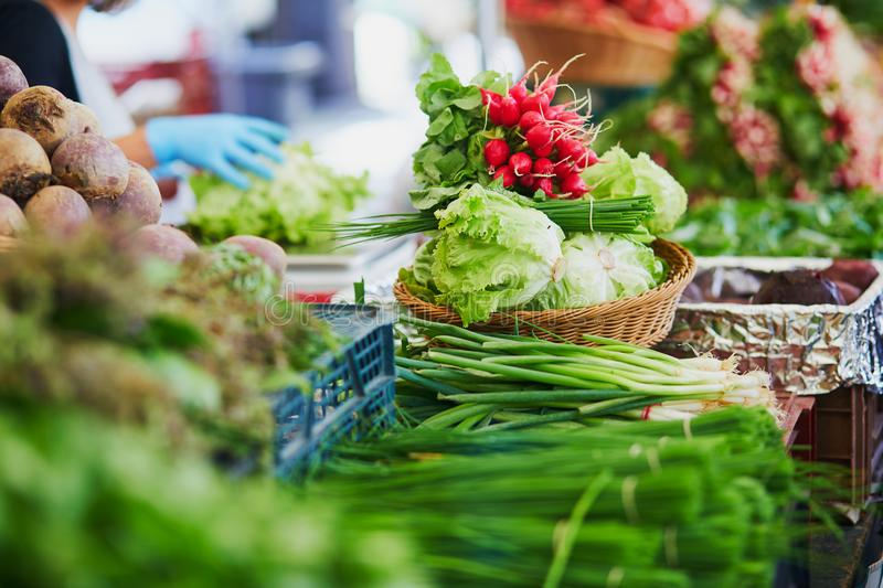 Fresh organic vegetables and fruits on farmer market in Paris, France royalty free stock photos