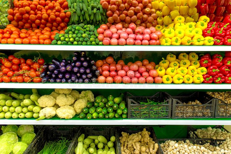 Fresh organic Vegetables and fruits on shelf in supermarket, farmers market. Healthy food concept. Vitamins and minerals. Tomatoes. Capsicum, cucumbers royalty free stock images