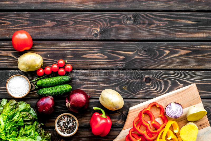 Fresh organic vegetables for healthy food cooking on dark wooden background top view mock up stock images