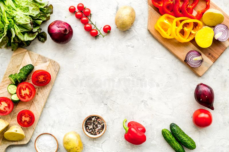 Fresh organic vegetables for healthy food cooking on light stone background top view mock up stock photos