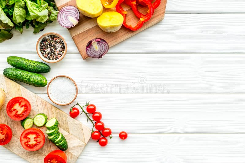 Fresh organic vegetables for healthy food cooking on white wooden background top view mock up stock photos