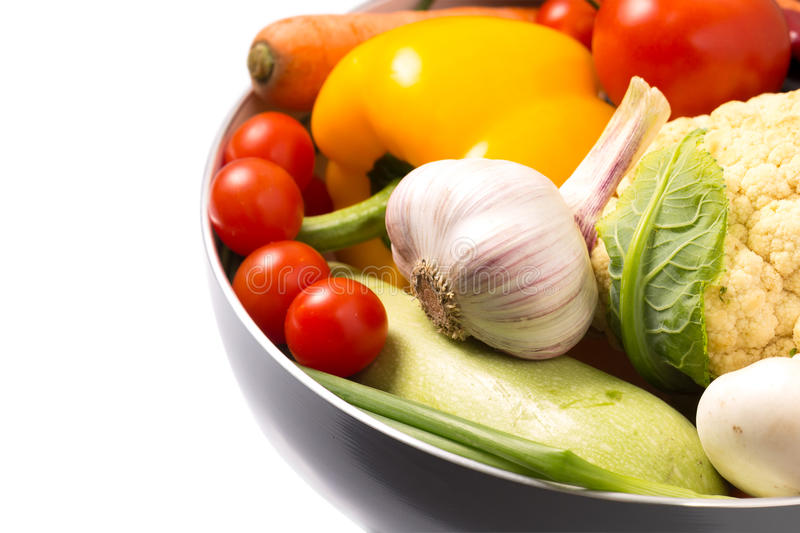 Fresh Organic Vegetables in a pot on White stock photography