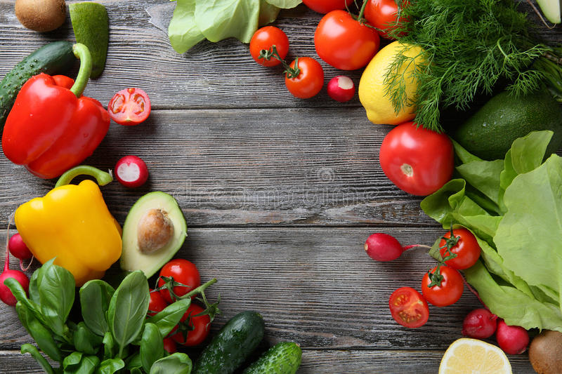 Fresh organic vegetables on wood boards. stock photography