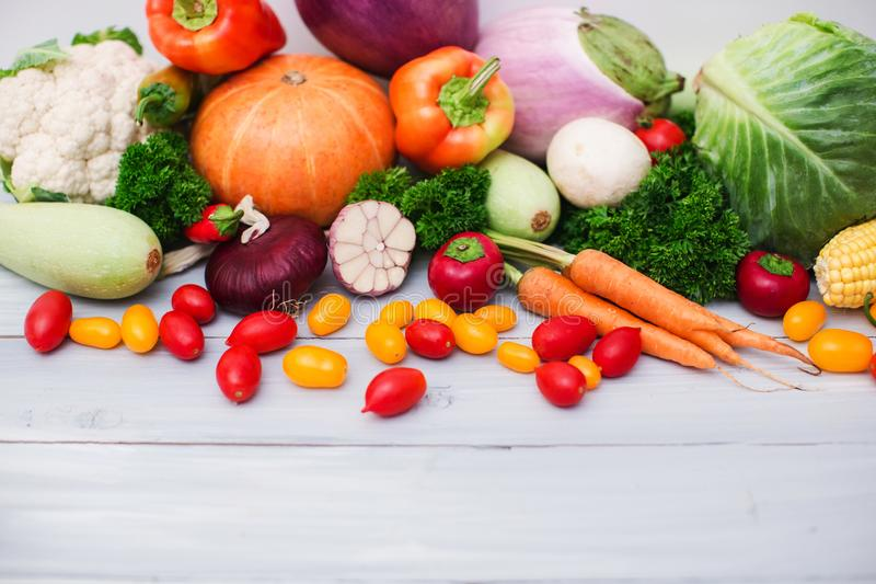 Fresh organic vegetables on wooden with copy space. stock image