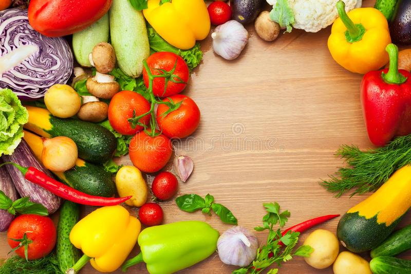 Fresh Organic Vegetables on wooden Table / Round royalty free stock photo