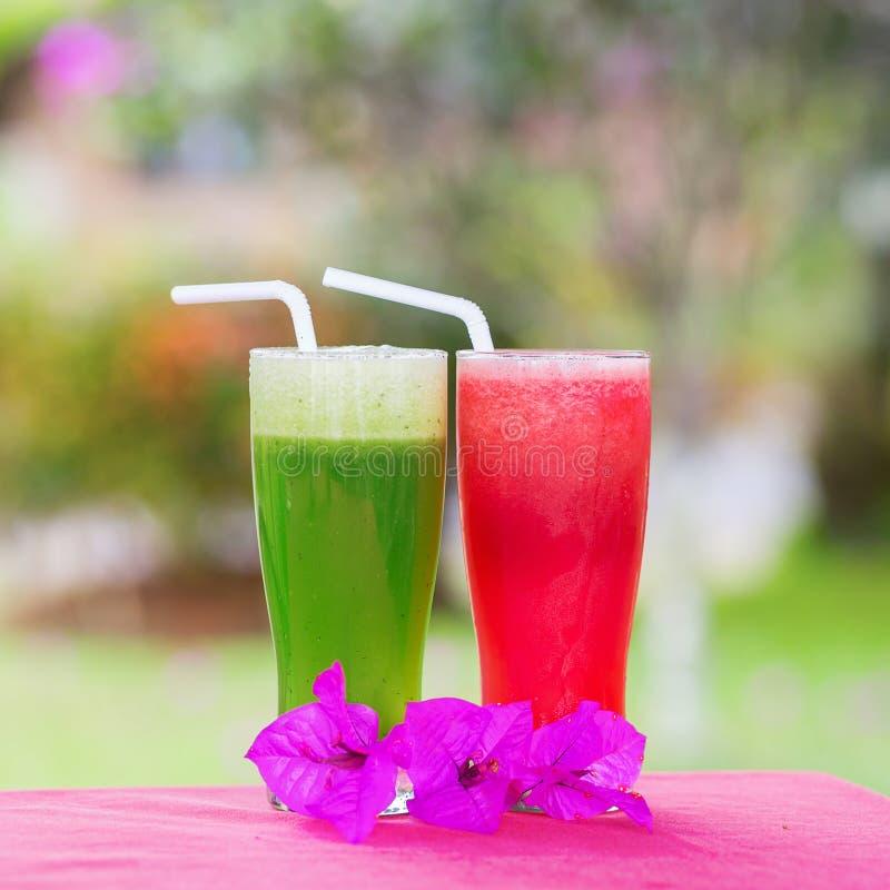 Fresh organic watermelon and cucumber juices stock photos