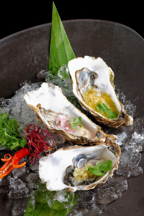Fresh Oysters with three sauces. (cilantro with lime juice, ginger vanilla and pinneaple with chili stock images
