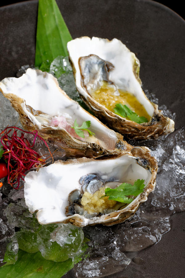 Fresh Oysters with three sauces. (cilantro with lime juice, ginger vanilla and pinneaple with chili stock photos