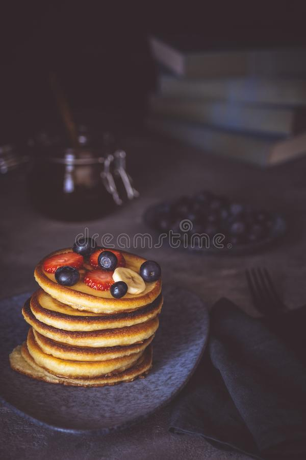 Fresh Pancakes with Organic Maple Syrup and Berries on Dark Background stock photo