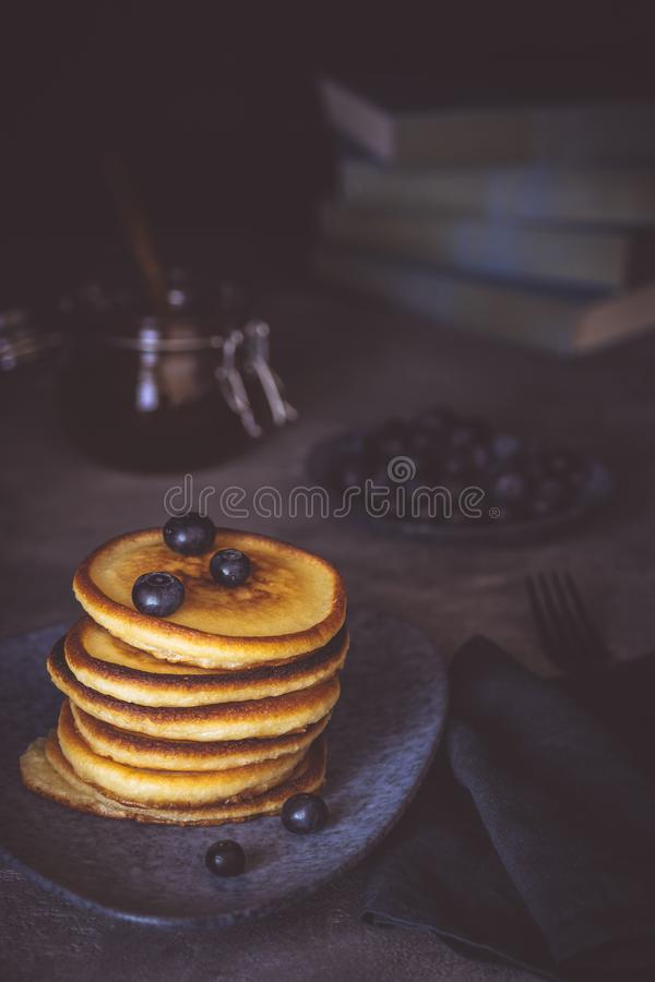 Fresh Pancakes with Organic Maple Syrup and Berries on Dark Background royalty free stock images