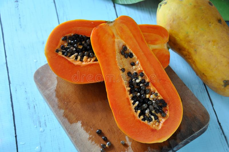 Fresh Papaya on Cutting Board stock photography