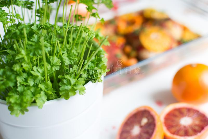 Fresh parsley and oranges royalty free stock photography