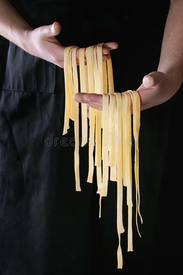 Free Fresh Pasta Tagliatelle In Man`s Hands Royalty Free Stock Photography - 87514967