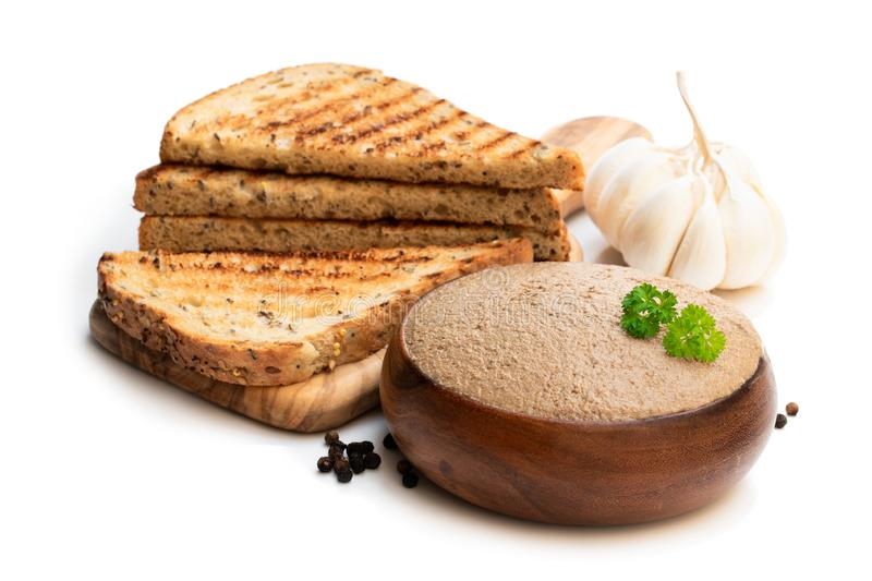 Fresh pate with toasted bread isolated on white royalty free stock images