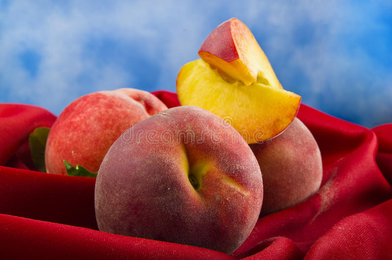 Fresh peach fruits with cut royalty free stock photos